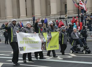 National Commander Dave Riley (seated in scooter) leads DAV's delegation of representatives down Pennsylvania Avenue during the inaugural parade for President Donald J. Trump. The delegation included (from left) Maryland Past Department Commander Lamarr Couser, National Interim Committee member Jim Procunier, Maryland Chapter 1 Adjutant Chuck Linton, Virginia Chapter 10 1st Junior Vice Commander Layton Lamphere and Riley's wife, Yvonne.